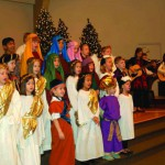 Elemetary Students singing and wearing Bible costumes.