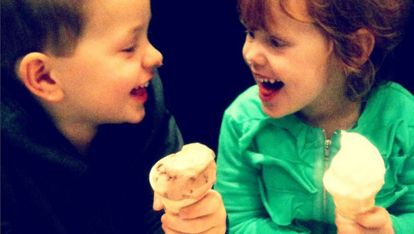 Two kids enjoying ice cream together