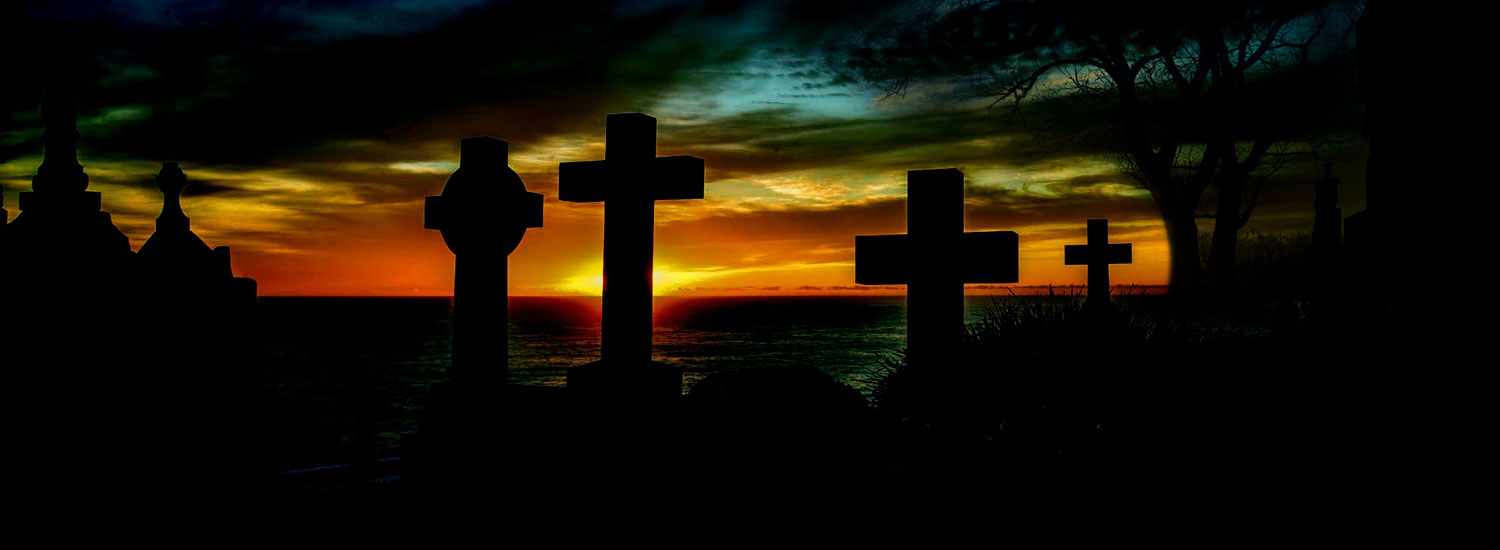 Grave yard crosses against setting sun.