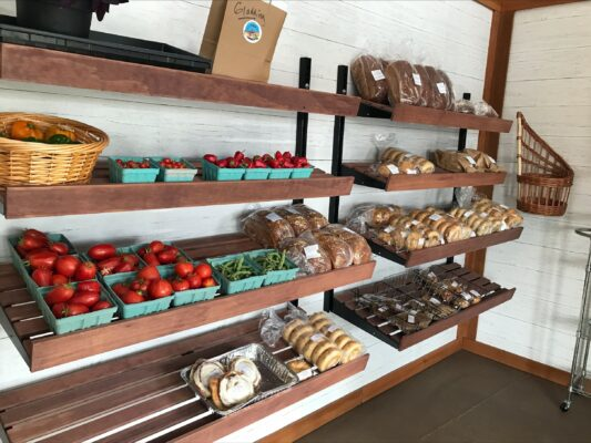Photo of fresh veggies & bakery items, examples of items available from Artisan Bakery & The Farm at UCA.